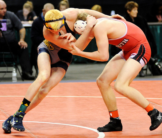 Don Knight |  The Herald Bulletin<br /> Shenandoah's Ryan Surguy wrestles Plymouth's Graham Calhoun for 7th place at 138 pounds in the consolation round of the wrestling state championship at Bankers Life Field House on Saturday.