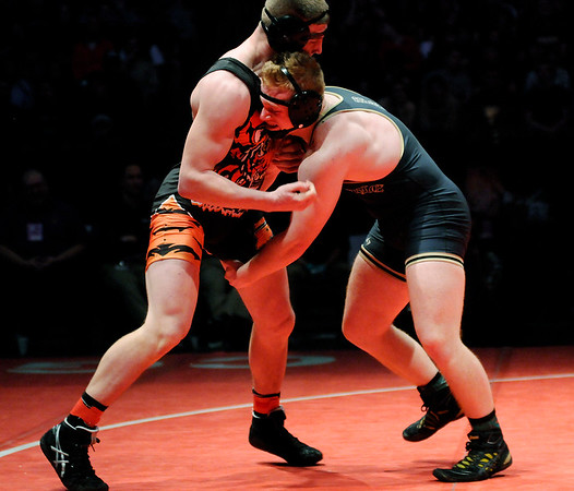 Don Knight |  The Herald Bulletin<br /> Daleville's Corbin Maddox wrestles Lawrenceburg's Mason Parris in the 220 pound championship at Bankers Life Fieldhouse on Saturday.