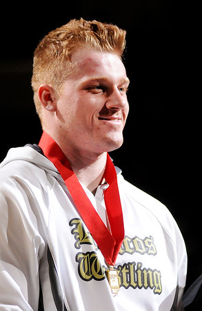 Don Knight    The Herald Bulletin<br /> Daleville's Corbin Maddox stands on the podium after receiving his second place medal during the wrestling state finals at Bankers Life Fieldhouse on Saturday.