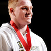 Don Knight |  The Herald Bulletin<br /> Daleville's Corbin Maddox stands on the podium after receiving his second place medal during the wrestling state finals at Bankers Life Fieldhouse on Saturday.