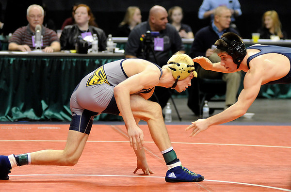 Don Knight |  The Herald Bulletin<br /> Shenandoah's Josh Gee wrestles Bellmont's Tony Busse for 7th place at 160 pounds in the consolation round of the wrestling state championship at Bankers Life Field House on Saturday.