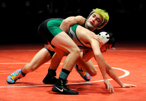 Don Knight |  The Herald Bulletin<br /> Shenandoah's AJ Black wrestles Yorktown's Brayden Curtis in the 106 pound state championship at Bankers Life Fieldhouse on Saturday.