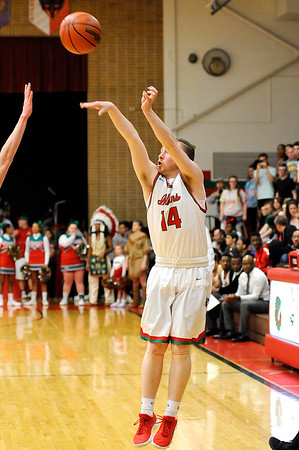 Don Knight | The Herald Bulletin<br /> Anderson's Gavin Vaughn shoots a three-point shot as the Indians hosted Guerin Catholic on Tuesdasy.