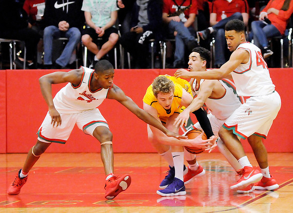 Don Knight | The Herald Bulletin<br /> From left, Anderson's JoMel Boyd, Ethen Russel and Brandon Haralson triple team Guerin Catholic's Jack Hansen forcing him so lose the ball as the Indians hosted the Golden Eagles on Tuesdasy.