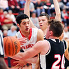 John P. Cleary |  The Herald Bulletin<br /> Frankton's Maurice Knight flips the ball out to a teammate after getting double teamed along the baseline.