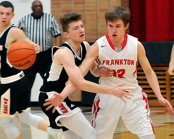 John P. Cleary |  The Herald Bulletin<br /> Frankton's Landon Weins, left, knocks the ball away from Knightstown's Dylan Hiner as he was bring the ball up court.