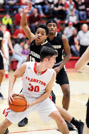 Don Knight   The Herald Bulletin<br /> Frankton's Kayden Key looks to pass as he is guarded by Mt. Vernon's Logan Smith on Thursday.