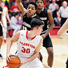Don Knight | The Herald Bulletin<br /> Frankton's Kayden Key looks to pass as he is guarded by Mt. Vernon's Logan Smith on Thursday.