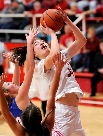 Don Knight | The Herald Bulletin<br /> Frankton's Destyne Knight draws a foul on a put back shot as the Eagles faced Elwood in a sectional semifinal on Friday.