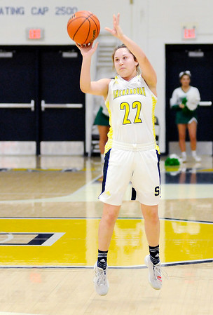Don Knight | The Herald Bulletin<br /> Shenandoah's Faith Muterspaugh releases a three-point shot as the Raiders hosted the Triton Central Tigers in the sectional final on Saturday.
