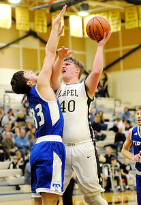 Don Knight | The Herald Bulletin Lapel's Caleb Bloom shoots over Tipton's Trent Seward as the Bulldogs hosted  the Blue Devils on Thursday.