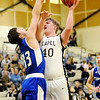 Don Knight | The Herald Bulletin<br /> Lapel's Caleb Bloom shoots over Tipton's Trent Seward as the Bulldogs hosted  the Blue Devils on Thursday.
