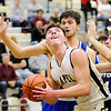 Don Knight | The Herald Bulletin<br /> Lapel's Luke Richardson looks to shoot from the low post as he is guarded by  Tipton's Trent Seward and Alec Weddell on Thursday.