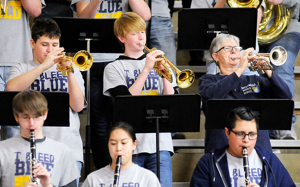 Don Knight | The Herald Bulletin<br /> Shenandoah band director Cathy Marshall plays her trumpet in the pep band as the Raiders hosted Wapahani on Friday.