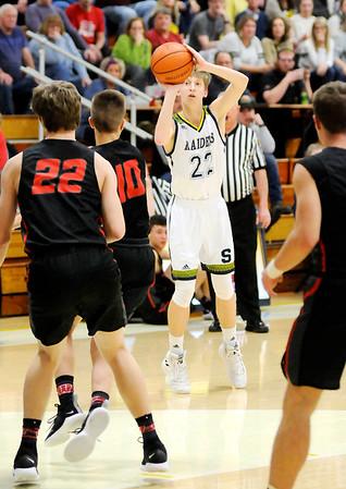 Don Knight   The Herald Bulletin<br /> Shenandoah's Kaden McCollough shoots a three-point basket as the Raiders hosted Wapahani on Friday.