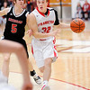 Don Knight | The Herald Bulletin<br /> Frankton's Travis McGuire drives as he is guarded by Sheridan's Drake Delph on Friday.