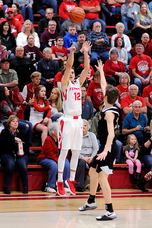 Don Knight | The Herald Bulletin<br /> Frankton's Landon Weins shoot a three-point shot as the Eagles hosted Sheridan on Friday.