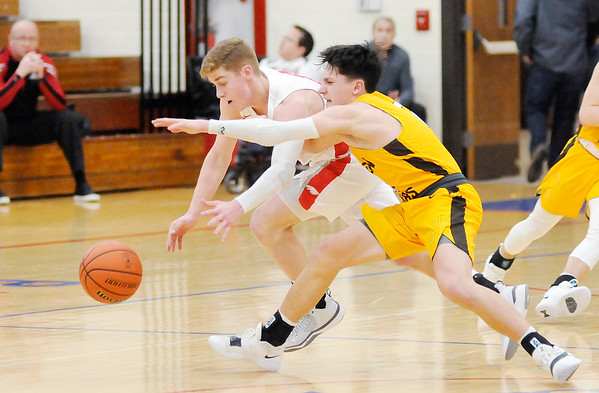 Don Knight   The Herald Bulletin<br /> Frankton's Brayton Cain knocks the ball away from Monroe Central's Ullom Jackson in the first round of the 2A sectional hosted by Elwood on Tuesday.