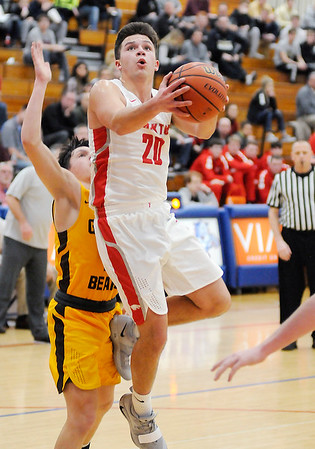 Don Knight | The Herald Bulletin<br /> Frankton's Jon Hatzell drives to the basket as the Eagles faced Monroe Central in the first round of the 2A sectional hosted by Elwood on Tuesday.