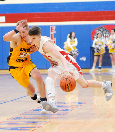 Don Knight   The Herald Bulletin<br /> Frankton's Ethan Bates draws a foul from Monroe Central's Sam Feola in the first round of the 2A sectional hosted by Elwood on Tuesday.