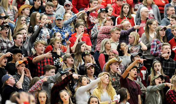 Don Knight | The Herald Bulletin<br /> Frankton students disagree with a foul call as the Eagles faced Monroe Central in the first round of the 2A sectional hosted by Elwood on Tuesday.
