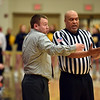 Richard Sitler | For The Herald Bulletin<br /> Knightstown Coach Dusty Magee asks for clarification from the official during first round sectional action at Knightstown Tuesday. Magee's Panthers fell to the Shenandoah Raiders 52-36.