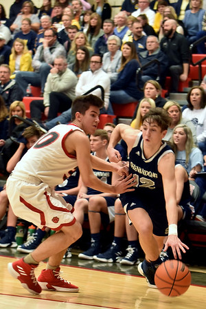 Richard Sitler | For The Herald Bulletin<br /> Shenandoah's Andrew Bennett drives past Knightstown defender Robert Porter during the fourth quarter of the IHSAA 2A Boys Basketball Sectionional 42 first round game between the Raiders and the Panthers at Knightstown, Tuesday February 26, 2019. Shenandoah defeated Knightstown 52-36.