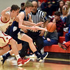 Richard Sitler | For The Herald Bulletin<br /> Knightstown's Austin Camptin and Shenandoah's Kaden McCollough battle for control of the ball during the second quarter of sectional action at Knightstown, Tuesday February 26, 2019.