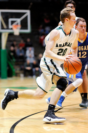 Don Knight | The Herald Bulletin<br /> Pendleton Heights' Trent Miller drives to the basket as the Arabians faced Greenfield-Central in the first round of the sectional at New Castle on Tuesday.