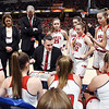 Frankton coach Stephen Hamaker goes over the game plan with the team before the start of the IHSAA 2A Girls State Basketball State Finals.