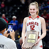 Frankton's Bailey Tucker is all smiles as she gets photographed after being named the Mental Attitude Award winner for class 2A girls basketball.