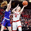 Frankton's Bailey Tucker eyes the basket for a shot as Linton-Stockton's haley Rose tries to defend.