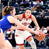Frankton's Addie Gardner gets pressured by Linton-Stockton's Vanessa Shafford as she tries to cut the lane.