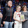 Frankton's Bailey Tucker receives the Patricia L. Roy Mental Attitude Award for class 2A girls basketball  with her parents Shannon and Bobby Tucker.