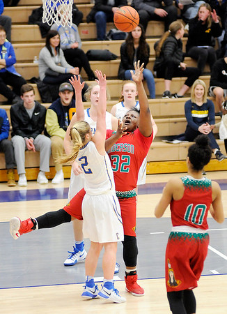 Don Knight | The Herald Bulletin<br /> Anderson's Kenigia Hamilton draws a foul from Carmel's Olivia Christy during the sectional semi-final at Hamilton Southeastern on Friday.