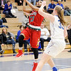 Don Knight | The Herald Bulletin<br /> Anderson's Antaria Hammond drives for a layup as she is guarded by Carmel's Mackenzie Wood in the sectional semi-final at Hamilton Southeastern on Friday.