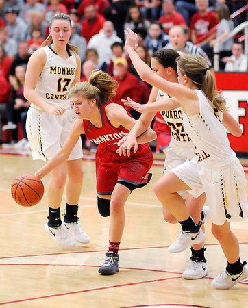 Don Knight | The Herald Bulletin<br /> Frankton's Sydney Tucker drives into the lane after running down her own rebound as the Eagles beat Monroe Central for the sectional championship on Saturday. Tucker scored a game high 31 points.