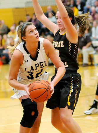 Don Knight |  The Herald Bulletin<br /> Lapel 's Breanna Boles looks to shoot as she is guarded by Monroe Central's Jordyn Barga during the sectional final at Monroe Central on Saturday.