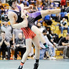 Don Knight | The Herald Bulletin<br /> Frakton's Dru Berkebile takes Guerin Catholic's JT Lazzara to the mat as he tries to escape in the 160 pound championship during the Wrestling regional at Pendleton Heights on Saturday.