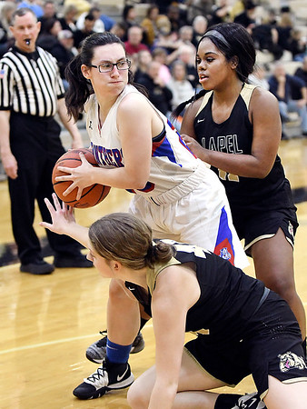 Elwood's Lexi Crosbie gets boxed in by Lapel's Makayla McDole and Morgan Knepp as she loses her dribble and is looking to pass the ball.
