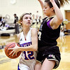 Elwood's Olivia Shannon looks toward the basket as she is blocked by Delany Peoples of Lapel.
