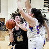 Lapel's Ashlynn Allman gets her path blocked by Elwood's Sydney Scott as she tries to drive the baseline.