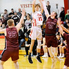 Don Knight   The Herald Bulletin<br /> Liberty Christian's Landan McCord shoots as he is guarded by Tri's Elijah Davis on Tuesday.
