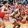 John P. Cleary | The Herald Bulletin<br /> Anderson's JoMel Boyd works on backing down Fishers' Terry Hicks as he works into the lane.