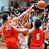 John P. Cleary | The Herald Bulletin<br /> Anderson's Joseph Jones gets the ball knocked out of his hands by Fishers' Terry Hicks as he was driving to the basket.