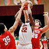 John P. Cleary | The Herald Bulletin<br /> Anderson's Keyounis Woods goes up between two Fishers defenders for a shot.