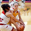 Alexandria's Jada Stansberry gets boxed in as Alexandria's Cagney Utterback goes for the ball.