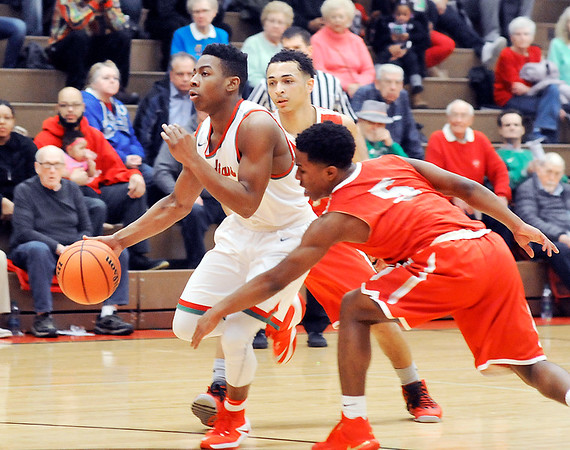 John P. Cleary    The Herald Bulletin<br /> Anderson's Keyounis Woods drives past two Fishers defenders going to the basket.