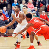 John P. Cleary |  The Herald Bulletin<br /> Anderson's Keyounis Woods drives past two Fishers defenders going to the basket.