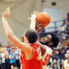 John P. Cleary |  The Herald Bulletin<br /> Anderson's Khalil Chamberlain goes up for a shot as Fishers Connor Wahburn gets a hand on the ball trying to block.